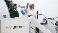 Pope Francis waves as he boards an airplane at Rome's Fiumicino airport on his way to a week-long trip to Mexico, Friday, Feb. 12, 2016. The pontiff is scheduled to stop in Cuba for an historical meeting with Russian Orthodox Patriarch Kirill that