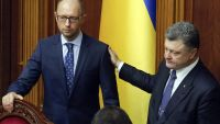 epa04848908 Ukrainian President Petro Poroshenko (R) congratulates Ukrainian Prime Minister Arseniy Yatsenyuk (L) after voting for constitutional changes on decentralizing power during parliament session in Kiev, Ukraine, 16 July 2015. The bill