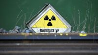 epa03013950 A radioactive sign is seen on a train carrying Castor nuclear waste, passes by Metz, eastern France, 24 November 2011. On the upcoming weekend, the 13th dry cask storage transport of radioactive waste from France will arrive in the Wendland,