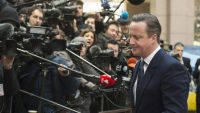 epa05169937 British Prime Minister David Cameron speaks to the media as he arrives for the second day of an extraordinary two-day EU summit at EU the headquarters in Brussels, Belgium, 19 February 2016. Negotiations over a reform deal that is meant to