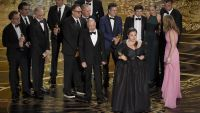 "Nicole Rocklin, pictured at front, and cast and crew of ""Spotlight"" accept the award for best picture for ""Spotlight"" at the Oscars on Sunday, Feb. 28, 2016, at the Dolby Theatre in Los Angeles. (Photo by Chris Pizzello/Invision/AP)"