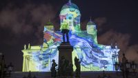 epa05090625 The work 'Images of Joy' is projected on the Helsinki Cathedral as part of the Lux Helsinki light festival, in Helsinki, Finland, 06 January 2016. National and international artists created artworks for the festival running 06