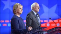 epa05198821 A handout photo provided by CNN shows US Democratic Presidential candidates Hillary Clinton (L) and Bernie Sanders during the CNN Democratic Presidential candidates' debate, at the Whiting Auditorium in Flint, Michigan, USA, 06 March 2016