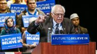 epa05200114 Vermont Senator and US Democratic presidential candidate Bernie Sanders speaks at a campaign event at the Michael A. Guido Theater in Dearborn, Michigan, USA, 07 March 2016. Residents will go to the polls to cast their votes in the Michigan