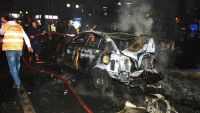epa05209889 Firefighters extinguish a burning car at the site  after an explosion in Ankara, Turkey 13 March 2016. The exploison which happened near a crowded bus station killed at least ten people and injured many others, according to latest reports of