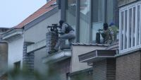 epa05213151 Security forces take position during a police operation in Forest, Brussels, Belgium, 15 March 2016. According to reports, police have stormed a flat where a suspected Islamist was hiding following a manhunt. The police operation took place