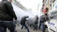 epa05232727 Anti-Islamic State (IS) demonstrators clash with Police at Place de la Bourse, at the site of the memorial for the victims of the 22 March terror attacks in Brussels, Belgium, 27 March 2016. The rally was originally cancelled by authorities,