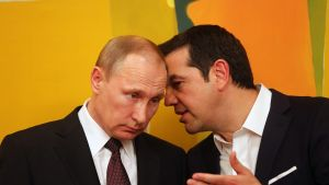 epa05332934 Greek Prime Minister Alexis Tsipras (R) talks with Russian President Vladimir Putin (L) during their meeting in Athens, Greece, on 27 May 2016. Vladimir Putin is in Greece on a two days visit.  EPA/ORESTIS PANAGIOTOU/POOL