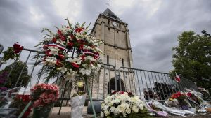epaselect epa05444192 People pay tribute at a makeshift memorial near the Saint Etienne church, where priest Jacques Hamel was killed, in Saint-Etienne-du-Rouvray, near Rouen, France, 27 July 2016. According to reports, two hostage takers were killed by