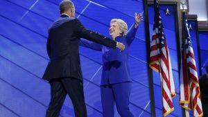 epa05444853 United States President Barack Obama embraces Democratic Nominee for President Hillary Clinton, after addressing the delegates on the third day of the Democratic National Convention at the Wells Fargo Center in Philadelphia, Pennsylvania, USA,