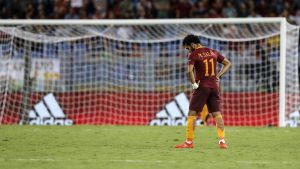 epa05508002 Roma's Mohamed Salah shows his dejection at the end of the UEFA Champions League qualification playoff round second leg soccer match between AS Roma and FC Porto at Stadio Olimpico in Rome, Italy, 23 August 2016.  EPA/ANGELO CARCONI