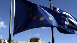 epa04645682 A Greek and a European Union flag wave across Acropolis hill, in Athens, Greece, on 3 March 2015. The Greek Government announced that Finance Minister Yanis Varoufakis will present a folder with six reform proposals to the Eurogroup meeting on