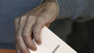 epa04764736 A man casts his vote at a polling station in Aravaca, Madrid, Spain, 24 May 2015. Voting got under way in Spain in crucial regional and local elections that are seen as a test of the conservative central government ahead of this autumn's