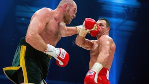 epa05046617 Ukrainian boxer Vladimir Klitschko (L), fights against British contender Tyson Fury during their world heavyweight title bout at the Esprit Arena in Duesseldorf, Germany, 28 November 2015. Tyson Fury of Britain is the new heavyweight world