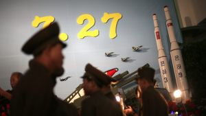FILE - In this July 26, 2013, file photo, North Korean soldiers walk past models of the Unha 3 space launch vehicle, left, which successfully delivered North Korea's first satellite into orbit, and the Unha 9, which would carry a lunar orbiter, on display