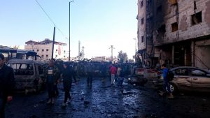epa05137378 Syrian people and soldiers inspect the site of bombing in the district of al-Sayeda Zainab in southern Damascus, Syria, 31 January 2016. Reports state at least 45 people were killed in three blasts near the Shiite shrine of al-Sayeda Zainab.