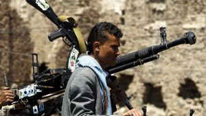 epa04989187 A member of Houthi militia rides a vehicle amid heightened security measures in Sana'a, Yemen, 22 October 2015. According to reports, Human Rights Watch has denounced that Houthi rebel forces have repeatedly fired mortar shells and