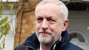 epa05051305 Labour party leader Jeremy Corbyn departs his home in London, Britain, 02 December 2015.  Members of Parliament are to debate and vote on Syria airstrikes at the House of Commons 02 December.  EPA/ANDY RAIN