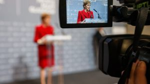 epa05291496 Leader of the Scottish National Party (SNP), Nicola Sturgeon is seen through the display of a video camera as she speaks to members of the audience after being re-elected to serve the Glasgow Southside at the Emirates Arena in Glasgow,