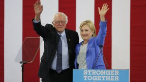 epa05422025 Democratic Presidential candidate Hillary Clinton (R) with former Democratic Presidential candidate Bernie Sanders as they appear together at an event at Portsmouth High School in Portsmouth, New Hampshire, USA, 11 July 2016. Sanders, who had