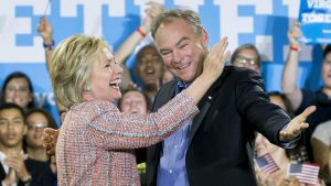 epa05425022 US Democratic presidential candidate Hillary Clinton (L) and Democratic Senator from Virginia Tim Kaine (R) gesture at a campaign event, at Ernst Community Cultural Center at the Northern Virginia Community College's Annandale campus, in