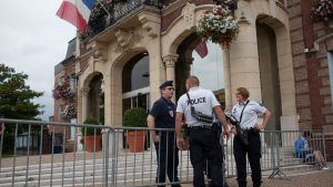 epa05442141 Police officers on guard in front of the city hall after a fatal hostage taking incident at a church in Saint-Etienne-du-Rouvray, near Rouen, France, 26 July 2016. According to reports, two hostage takers were killed by the police after they
