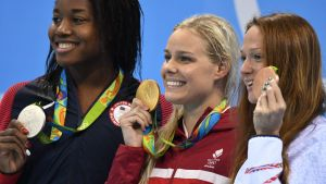 epa05482788 Silver medalist Simone Manuel of USA (L-R), Gold medalist Pernille Blume of Denmark, and Bronze medalist Aliaksandra Herasimenia of Belarus pose for on the podium during the medal ceremony for the women's 50m Freestyle Final race of the
