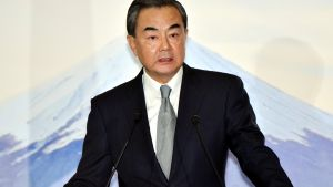 China's Foreign Minister Wang Yi reads his statement after a trilateral meeting with Japan and South Korea in Tokyo, Wednesday, Aug. 24, 2016. (Katsumi Kasahara/Pool Photo via AP)