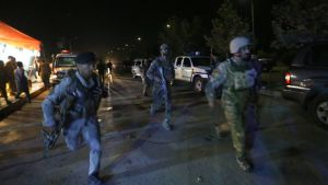 Afghan security forces rush to respond to a complex Taliban attack on the campus of the American University in the Afghan capital Kabul on Wednesday, Aug. 24, 2016. University President Mark English told The Associated Press that security forces had