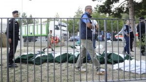 epa05509114 Recovered bodies lay covered on the ground in Pescara del Tronto, where a 6.2 magnitude earthquake struck just after 3:30 am (CET), Pescara del Tronto, Italy, 24 August 2016. The quake was felt across a broad section of central Italy, in