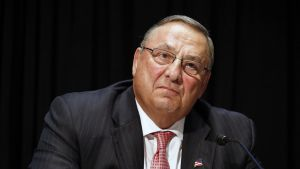 FILE- In this June 7, 2016, file photo, Maine Gov. Paul LePage attends an opioid abuse conference in Boston. LePage is being accused again of making racially insensitive comments, this time by saying photos he's collected in a binder of drug dealers