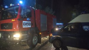 epa05527853 Fire truck and ambulance car from the Skopje's airport pass next to a police van blocking the access road towards the crash area where a small airplane crashed this evening near Kozle village,  10 km south of capitol Skopje, The Former