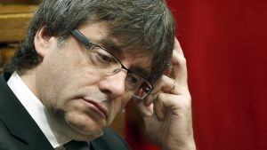 epa05445193 Catalonian President Carles Puigdemont reacts during a plenary session at the Catalonian Parliament in Barcelona, northeastern Spain, 28 July 2016. Catalonian Parliament the previous day passed conclusions on a constituent process, relating to