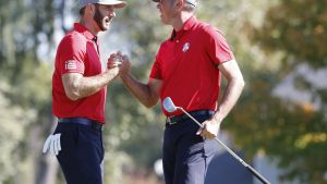 epa05564280 Dustin Johnson (L) of the US and Matt Kuchar of the US (R) celebrate after winning their Foursomes match on the fourteenth hole during the Ryder Cup 2016 at the Hazeltine National Golf Club in Chaska, Minnesota, USA, 30 September 2016. The