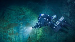 In this underwater photo taken Aug. 15, 2015 in the flooded Hranicka Propast, or Hranice Abyss, in the Czech Republic Polish explorer Slawomir Packo is exploring the limestone abyss and preparing for deeper exploration with the use of a remotely-operated