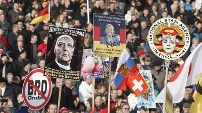 epa05146351 Participants in a rally from the xenophobic and anti-Islamic Pegida (Patritotic Europeans against the Islamization of the West) group gather in Dresden,Germany, 06 February 2016. Pegida has called for an international day of action. EPA