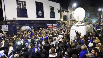 epa05287437 Leicester City supporters celebrate after the English Premier League soccer match between Chelsea and Tottenham Hotspur, in Leicester, Britain, 02 May 2016. Leicester was crowned English Premier League champions for the first time in the club&