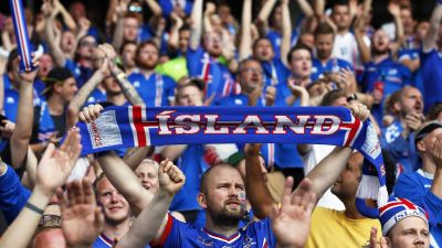 epa05395030 Iceland fans cheer for their team before the UEFA EURO 2016 round of 16 match between England and Iceland at Stade de Nice in Nice, France, 27 June 2016.