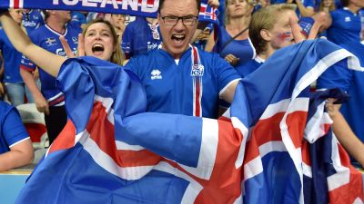epa05395476 Supporters of Iceland celebrate after the UEFA EURO 2016 round of 16 match between England and Iceland at Stade de Nice in Nice, France, 27 June 2016.