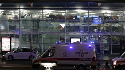 epa05396889 epa05396883 Medics wait for helping wounded people after an suicide bomb attack at Ataturk Airport in Istanbul, Turkey, 28 June 2016. At least 10 people were killed in two separate explosions that hit Ataturk Airport.  EPA/SEDAT SUNA  EPA