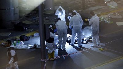 epa05396932 Crime scene investigators work next to a body after a suicide bomb attack at Ataturk Airport in Istanbul, Turkey, 28 June 2016. At least 10 people were killed and scores injured in two separate explosions that hit Ataturk Airport.  EPA/SEDAT