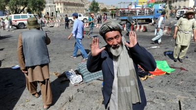 epa05437824 A man from Hazara minority reacts after a suicide bomb attack that targeted a demonstration of Hazara minority in Kabul, Afghanistan, 23 July 2016. According to reports at least 20 people were killed and more than 150 injured when a bomb