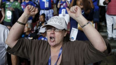 epa05440830 Delegates cheer and jeer on the first day of the Democratic National Convention at the Wells Fargo Center in Philadelphia, Pennsylvania, USA, 25 July 2016. The four-day convention is expected to end with Hillary Clinton formally accepting the