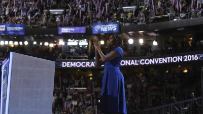 epa05441296 First Lady of the United States, Michelle Obama (C) speaks on the first day of the Democratic National Convention at the Wells Fargo Center in Philadelphia, Pennsylvania, USA, 25 July 2016. The four-day convention is expected to end with