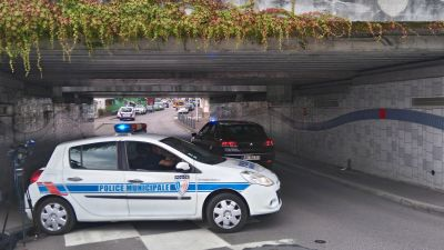 epa05441535 A municipal police vehicle blocks an underpass leaiing to the scene of a hostage taking incident in Saint Etienne du Rouvray, near Rouen, France, 26 July 2016. According to reports, two hostage takers were killed by the police after they took