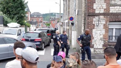 epa05441688 Police guards the area near to the scene of a hostage taking incident in Saint Etienne du Rouvray, near Rouen, France, 26 July 2016. According to reports, two hostage takers were killed by the police after they took hostages at a church in