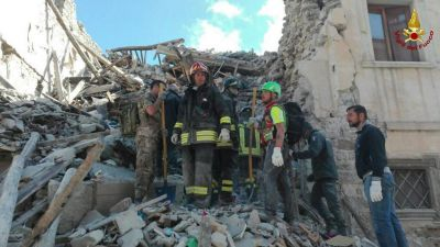 epa05508430 A handout image provided by the Italian Fire brigade shows italian fireworks working on collapsed and damaged houses in Amatrice, central Italy, 24 August 2016, following a 6.2 magnitude earthquake, according to the United States Geological