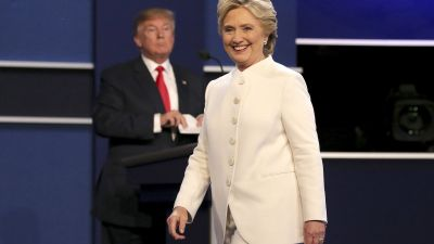 epaselect epa05593217 US Democratic candidate Hillary Clinton (R) and US Republican candidate Donald Trump (L) look on at the end of the final Presidential Debate at the University of Nevada-Las Vegas in Las Vegas, Nevada, USA, 19 October 2016. The debate