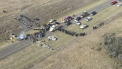 epa05606380 A handout picture made available by the Morton County Sheriff's Department shows an aerial view of protesters and law enforcement personnel confronting each other during a demonstration against the North Dakota oil pipeline project, along