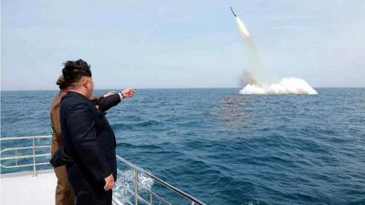 epa04739482 An image obtained by Yonhap News Agency showing North Korean leader Kim Jong-un pointing at a ballistic missile believed to have been launched from underwater near Sinpo, on the northeast coast of North Korean, 09 May 2015. The KCNA, the North